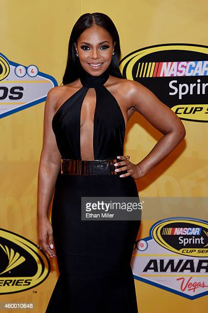 Singer/actress Ashanti arrives on the red carpet prior to the 2014 NASCAR Sprint Cup Series Awards at Wynn Las Vegas on December 5 2014 in Las Vegas...