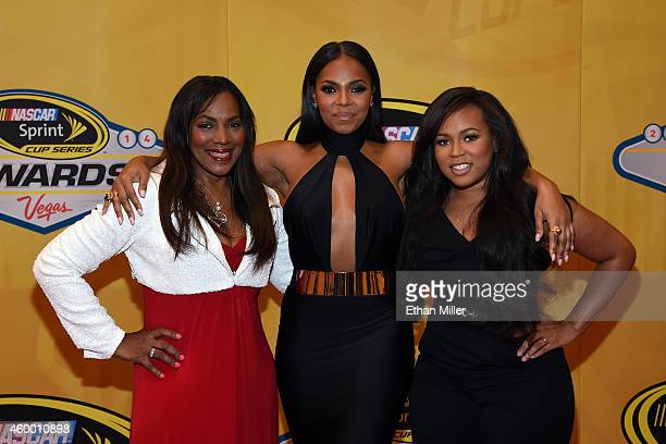 Singer/actress Ashanti arrives on the red carpet with her mother and manager Tina Douglas and her sister Shia Douglas prior to the 2014 NASCAR Sprint...