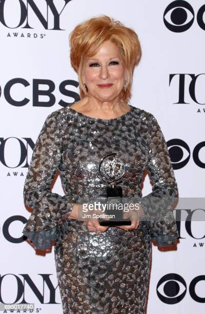 Singer/actress Bette Midler winner of the award for Best Actress in a Musical for 'Hello Dolly' poses in the press room for the 71st Annual Tony...