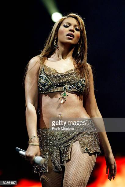 Singer/actress Beyonce Knowles performs onstage during the second stop on the Verizon Ladies First Tour 2004 at the New Orleans Arena March 14 2004...