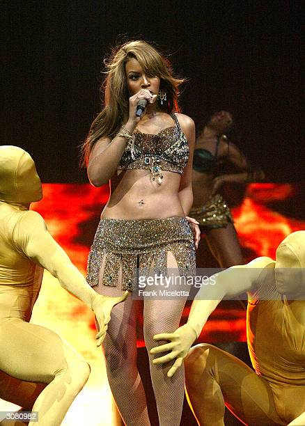 """Singer/actress Beyonce Knowles performs onstage during the start of the """"Verizon Ladies First Tour 2004"""" at the Office Depot Center March 12, 2004 in..."""