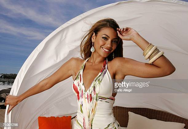 Singer/actress Beyonce Knowles poses for a photo during a portrait session for the cast of 'Dreamgirls' at the Carlton Hotel's Orange Lounge during...