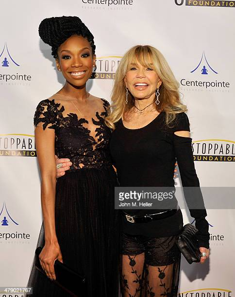 Singer/Actress Brandy and actress Dyan Cannon attend the 5th Annual Unstoppable Gala at the Hyatt Regency Century Plaza Hotel on March 15 2014 in...