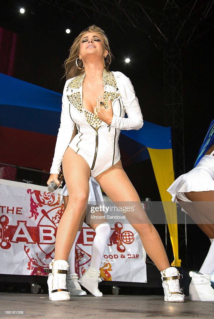 Singer/actress Carmen Electra performs at the Circus Xtreme T-Dance during Jeffrey Sanker presents White Party Palm Springs 2013 Day 3 at the White Party Park on March 31, 2013 in Palm Springs, California.