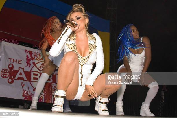 Singer/actress Carmen Electra performs at the Circus Xtreme TDance during Jeffrey Sanker presents White Party Palm Springs 2013 Day 3 at the White...