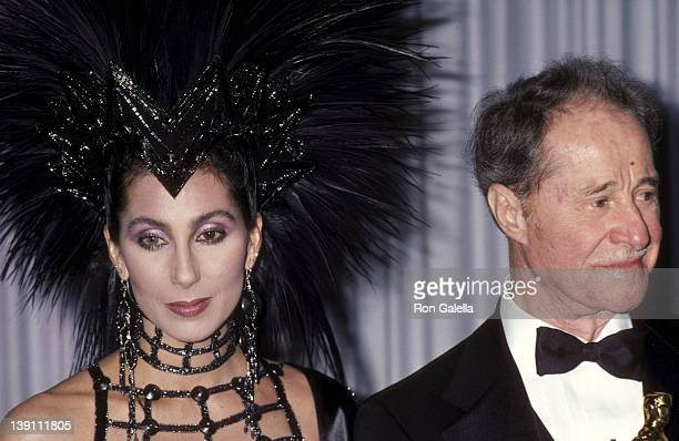 Singer/Actress Cher and actor Don Ameche attend the 58th Annual Academy Awards on March 24 1986 at Dorothy Chandler Pavilion Los Angeles Music Center...