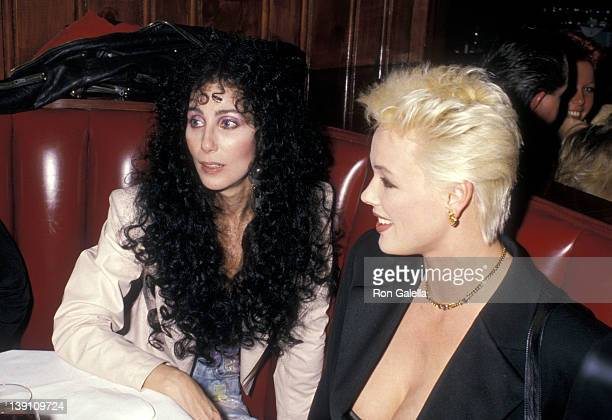 Singer/Actress Cher and actress Brigitte Nielsen attend the 15th Annual American Music Awards After Party on January 25 1988 at Chasen's Restaurant...