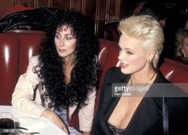 Singer/Actress Cher and actress Brigitte Nielsen attend the 15th Annual American Music Awards After Party on January 25, 1988 at Chasen's Restaurant...