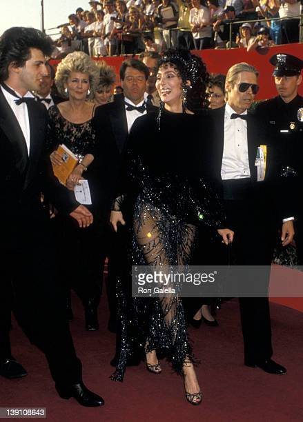 Singer/Actress Cher and boyfriend Rob Camilletti attend the 60th Annual Academy Awards on April 11 1988 at Shrine Auditorium in Los Angeles California