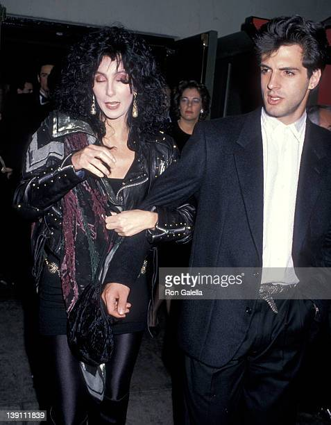 Singer/Actress Cher and boyfriend Rob Camilletti attend the 'Scrooged' Hollywood Premiere on November 7 1988 at Mann's Chinese Theatre in Hollywood...