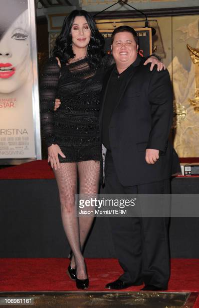 Singer/actress Cher and Chaz Bono pose as Cher is immortalized with hand and footprint ceremony at Grauman's Chinese Theatre on November 18 2010 in...
