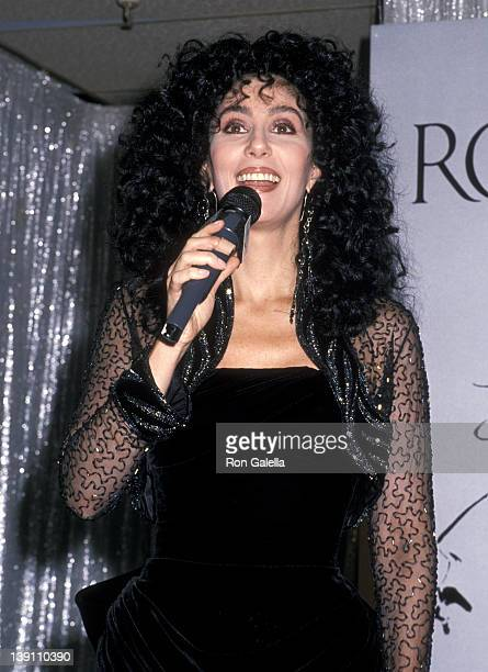 """Singer/Actress Cher promotes her new fragrance """"Uninhibited"""" on November 14, 1988 at Robinsons-May Department Store, Del Amo Fashion Center in..."""