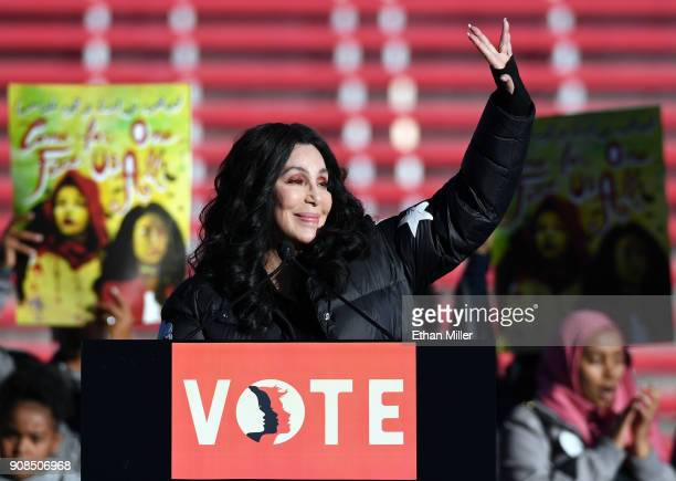Singer/actress Cher waves after speaking during the Women's March Power to the Polls voter registration tour launch at Sam Boyd Stadium on January 21...