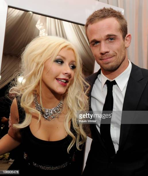 Singer/actress Christina Aguilera and actor Cam Gigandet pose at the after party for the premiere of Screen Gems' Burlesque at The W Hotel on...