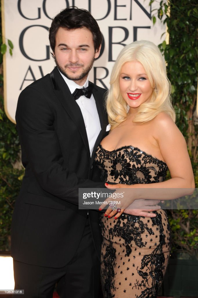 Singer/actress Christina Aguilera (R) and boyfriend Matt Rutler arrives at the 68th Annual Golden Globe Awards held at The Beverly Hilton hotel on January 16, 2011 in Beverly Hills, California.