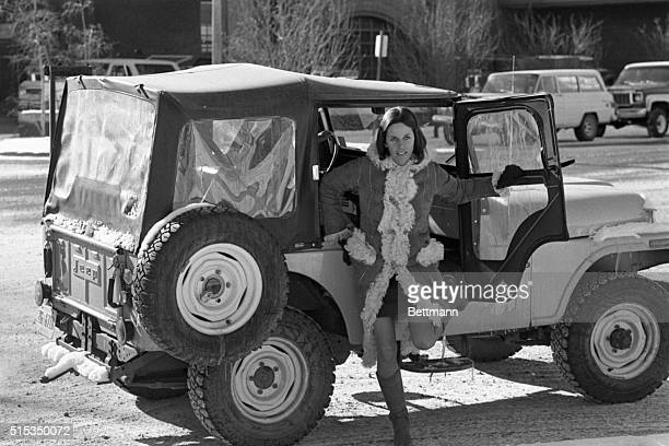 Singeractress Claudine Longet jumps out of a friend's jeep as she returns to the Pitkin county Court House from lunch here Jan 6 Miss Longet is on...