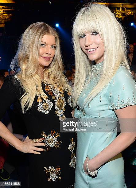 Singer/actress Fergie and singer Kesha attend the 2013 NewNowNext Awards at The Fonda Theatre on April 13 2013 in Los Angeles California