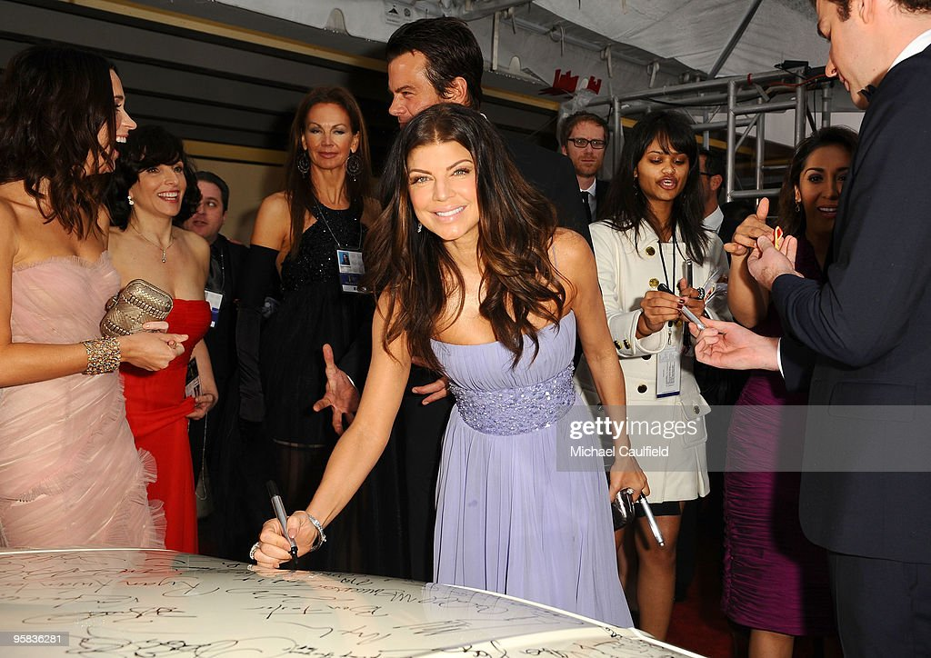 Celebrities Sign Charity Car At 67th Annual Golden Globe Awards : News Photo