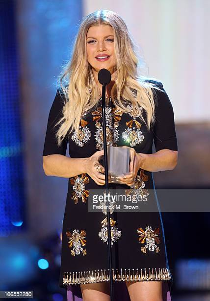 Singer/actress Fergie speaks onstage during the 2013 NewNowNext Awards at The Fonda Theatre on April 13 2013 in Los Angeles California
