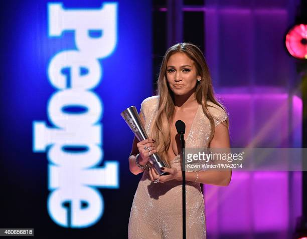 Singer/actress Jennifer Lopez accepts the Triple Threat award onstage during the PEOPLE Magazine Awards at The Beverly Hilton Hotel on December 18...