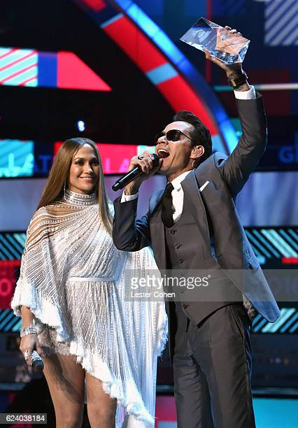 Singer/actress Jennifer Lopez and Person of the Year award honoree Marc Anthony speak onstage during The 17th Annual Latin Grammy Awards at TMobile...
