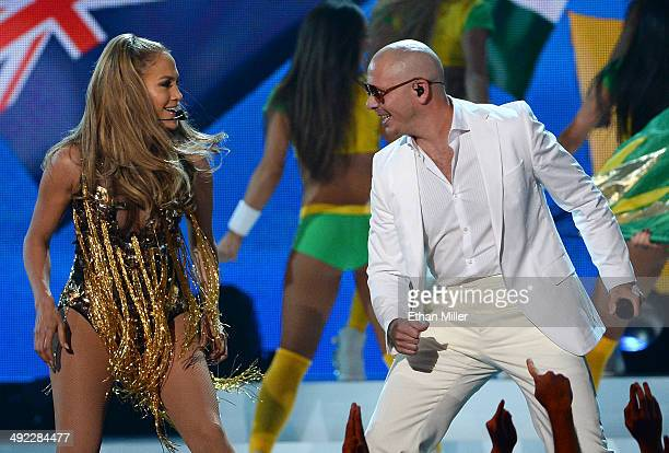 Singer/actress Jennifer Lopez and recording artist Pitbull perform onstage during the 2014 Billboard Music Awards at the MGM Grand Garden Arena on...