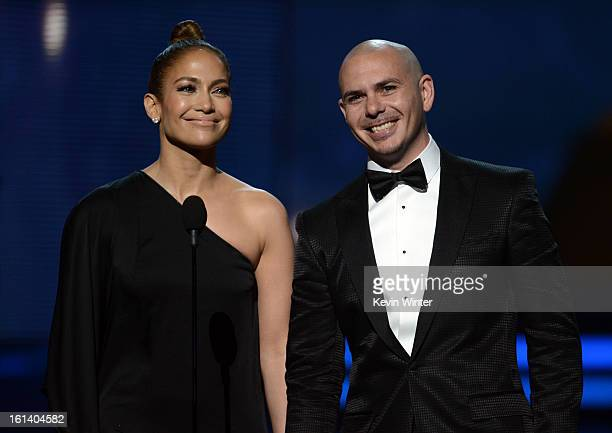 Singer/actress Jennifer Lopez and recording artist Pitbull speak onstage during the 55th Annual GRAMMY Awards at STAPLES Center on February 10 2013...