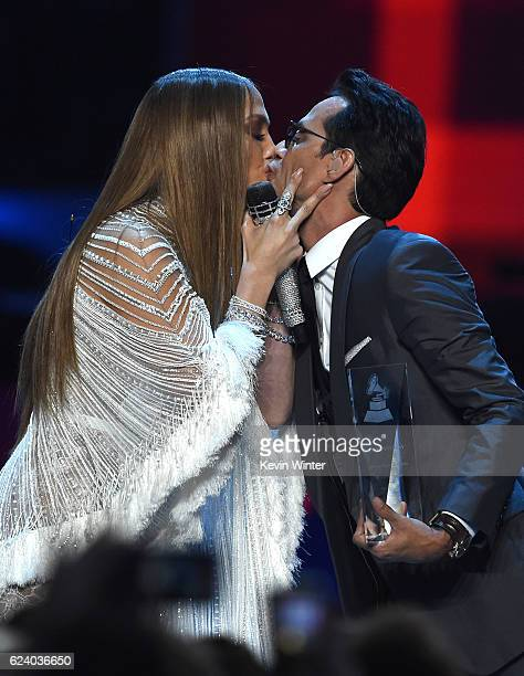 Singer/actress Jennifer Lopez and singer Marc Anthony kiss onstage during The 17th Annual Latin Grammy Awards at TMobile Arena on November 17 2016 in...