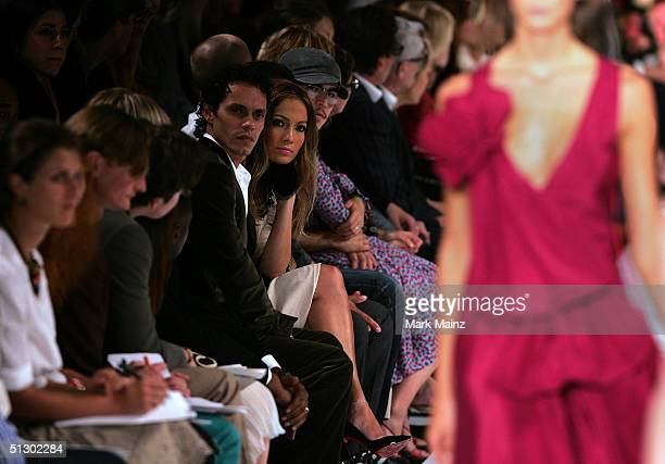 Singer/actress Jennifer Lopez and singer Marc Anthony watch the runway at the Marc Jacobs show during Olympus Fashion Week Spring 2005 in Bryant Park...