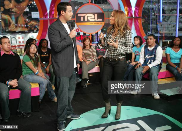 Singer/actress Jennifer Lopez appears on stage with MTV VJ Carson Daly during MTV's Total Request Live at the MTV Times Square Studios October 14...