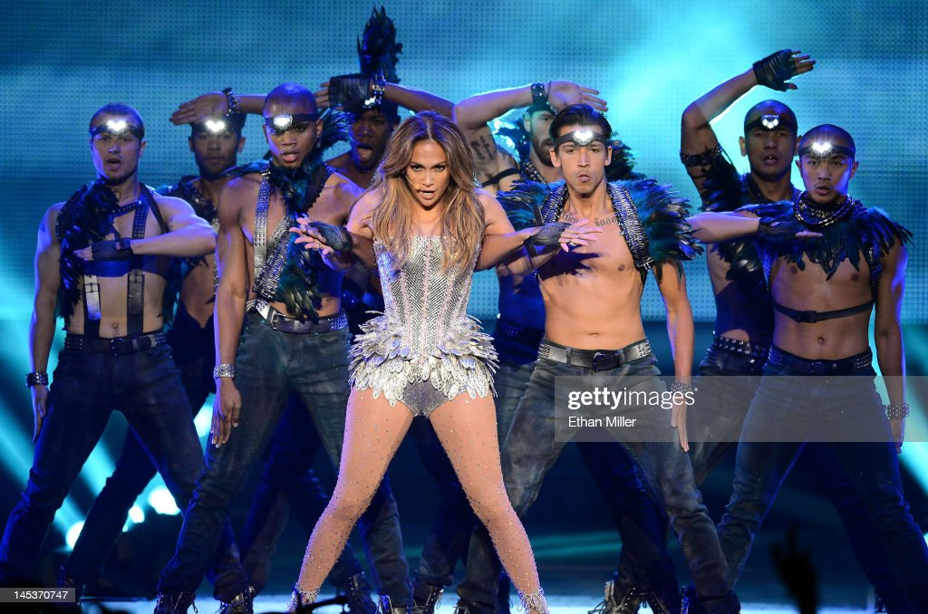 Singer/actress Jennifer Lopez (C) performs with dancers during the Q'Viva! The Chosen Live show at the Mandalay Bay Events Center on May 26, 2012 in Las Vegas, Nevada.