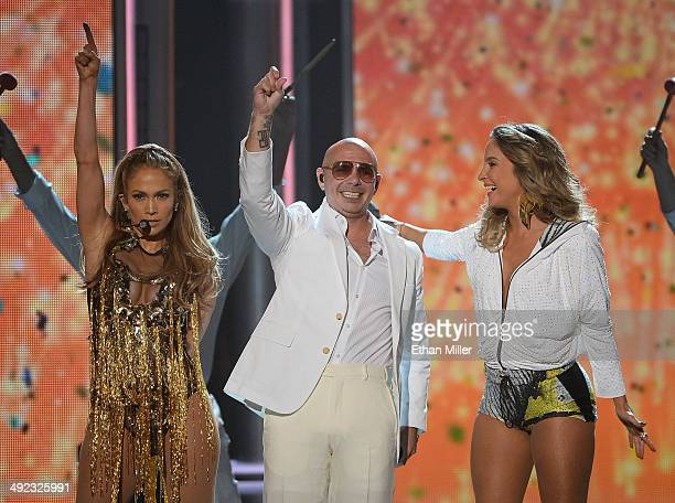 Singer/actress Jennifer Lopez recording artist Pitbull and singer Claudia Leitte perform onstage during the 2014 Billboard Music Awards at the MGM...