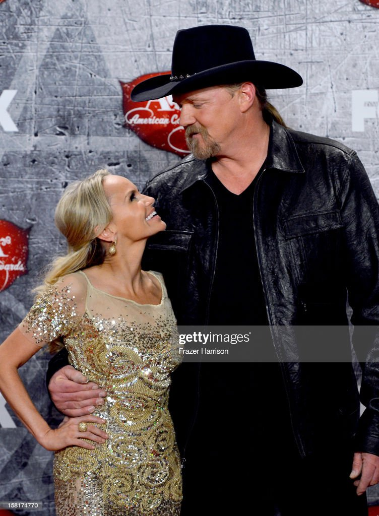 Singer/actress Kristin Chenoweth (L) and singer Trace Adkins pose in the press room during the 2012 American Country Awards at the Mandalay Bay Events Center on December 10, 2012 in Las Vegas, Nevada.