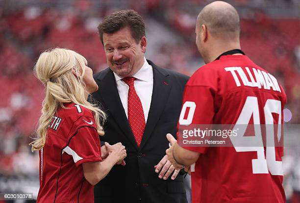 Singer/actress Kristin Chenoweth shakes hands with Arizona Cardinals owner Michael Bidwell prior to the NFL game between the New England Patriots and...