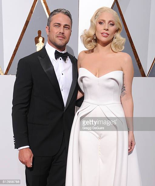 Singer/actress Lady Gaga and actor Taylor Kinney arrive at the 88th Annual Academy Awards at Hollywood & Highland Center on February 28, 2016 in...
