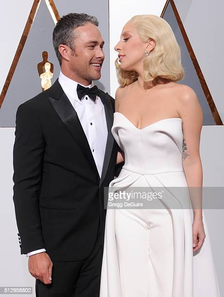 Singer/actress Lady Gaga and actor Taylor Kinney arrive at the 88th Annual Academy Awards at Hollywood Highland Center on February 28 2016 in...
