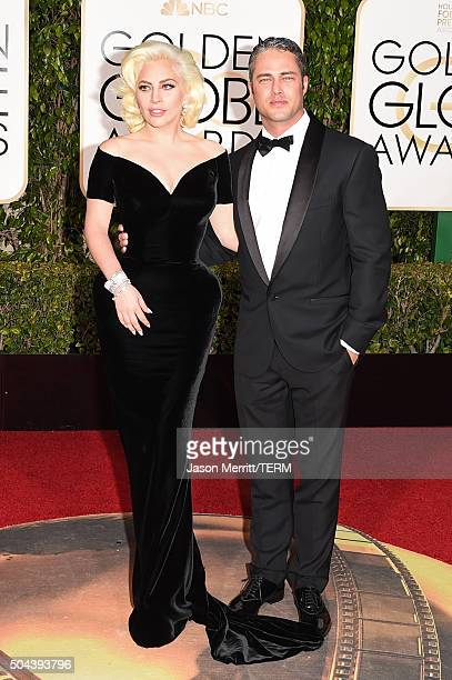Singer/actress Lady Gaga and actor Taylor Kinney attend the 73rd Annual Golden Globe Awards held at the Beverly Hilton Hotel on January 10, 2016 in...