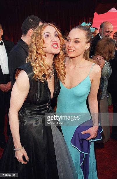 Singeractress Madonna arrives with singer Fiona Apple at the 70th Annual Academy Awards 23 March 1998 at Shrine Auditorium in Los Angeles CA AFP...