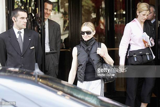 Singer/Actress Madonna leaves her hotel during a stay in Paris at the Four Season's Hotel on September 2 2004 in Paris France