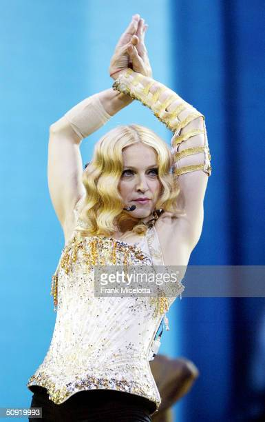 Singer/actress Madonna performs onstage during her 'ReInvention' World Tour 2004 at the Arrowhead Pond June 2 2004 in Anaheim California The outfit...