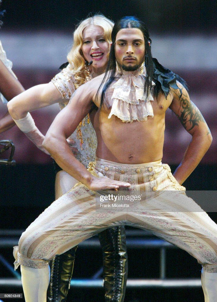 Singer/actress Madonna performs onstage during her 'Re-Invention' World Tour 2004 at the Arrowhead Pond, June 3, 2004 in Anaheim, California. The outfit she is wearing is designed by Christian LaCroix.