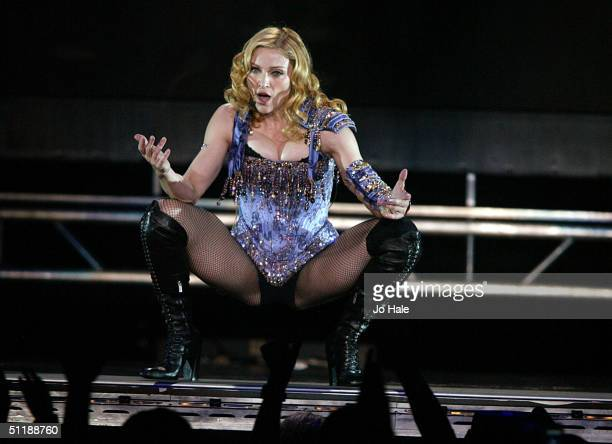 Singer/actress Madonna performs onstage during the first London date of the UK leg of her ReInvention World Tour 2004 at Earls Court on August 18...