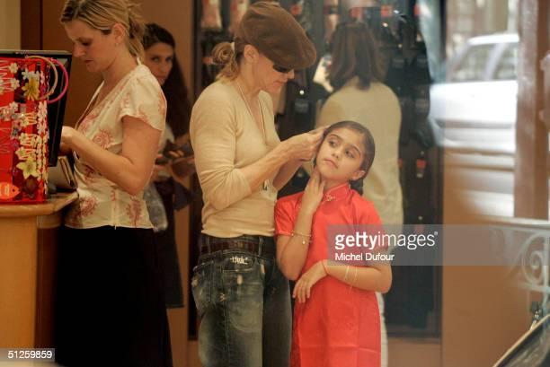 Singer/Actress Madonna shops with her daughter Lourdes on September 3 2004 in Paris France