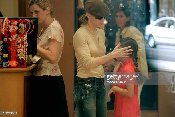Singer/Actress Madonna shops with her daughter Lourdes on September 3 2004 in Paris France