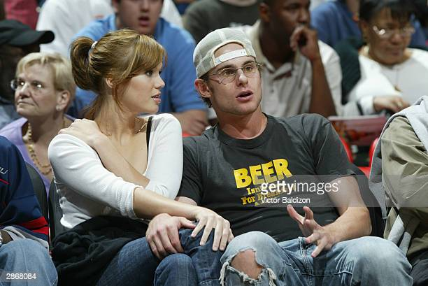 Singer/Actress Mandy Moore and tennis star Andy Roddick sit courtside at the game between the New York Knicks and the Miami Heat on December 27 2003...