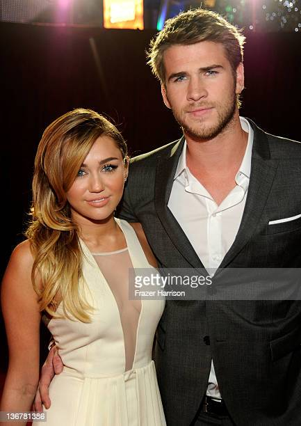Singer/Actress Miley Cyrus and actor Liam Hemsworth arrive at the 2012 People's Choice Awards at Nokia Theatre LA Live on January 11 2012 in Los...