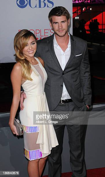 Singer/actress Miley Cyrus and actor Liam Hemsworth arrive for the 2012 People's Choice Awards held at Nokia Theatre LA Live on January 11 2012 in...