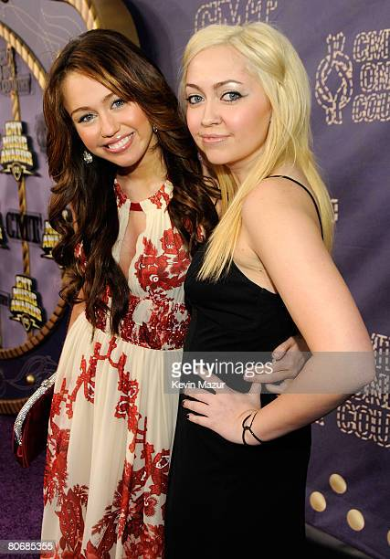 Singer/actress Miley Cyrus and Brandi Cyrus attends the 2008 CMT Music Awards at Curb Event Center at Belmont University on April 14, 2008 in...