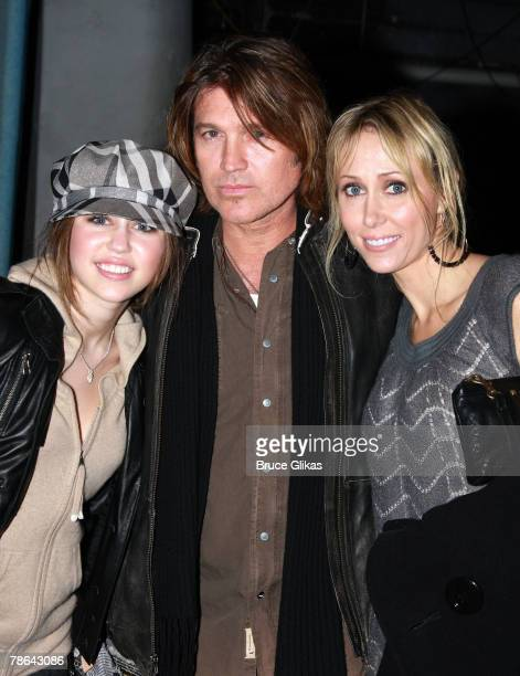 """Singer/Actress Miley Cyrus, father Billy Ray Cyrus and mother Leticia """"Tish"""" Cyrus pose as they visit backstage at """"Mamma Mia!"""" on Broadway at The..."""
