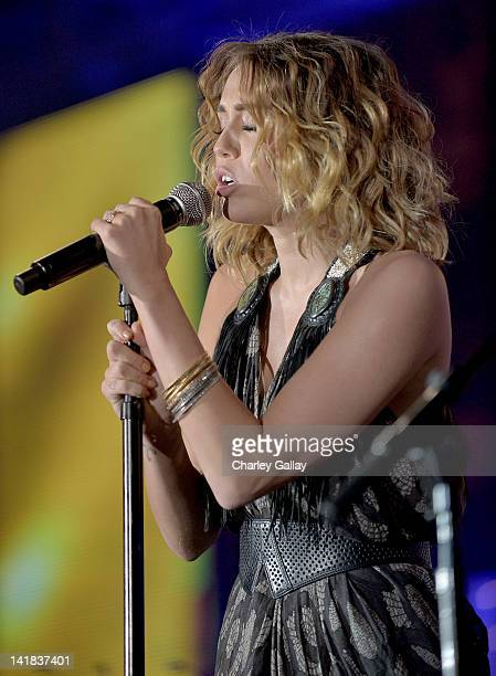 Singer/actress Miley Cyrus performs onstage during Muhammad Ali's Celebrity Fight Night XVIII held at JW Marriott Desert Ridge Resort Spa on March 24...